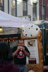 Giant cannoli and noshing man