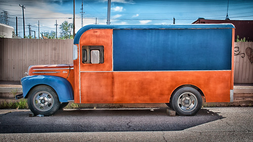 blue and orange delivery truck