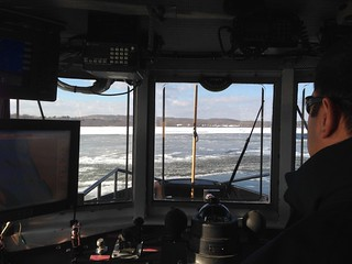 Senior Chief Aron Brewer, officer in charge of Coast Guard Cutter Bollard, looks on as the vessel breaks ice in the Connecticut River north of the Haddam Bridge. The 65-foot harbor tug is a critical ice-breaking asset in small harbors and rivers due to its shallow draft and high maneuverability. (U.S. Coast Guard photo)