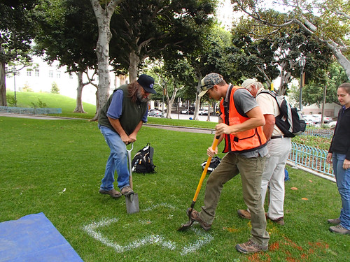 Kit Paris and Randy Riddle with the USDA Natural Resources Conservation Service are taking soil samples in downtown Los Angeles. (NRCS photo)
