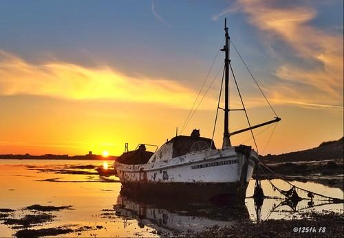 sunset summer sky coast boat lifeboat guernsey