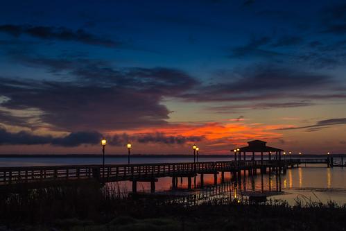 sunset water sunrise pier