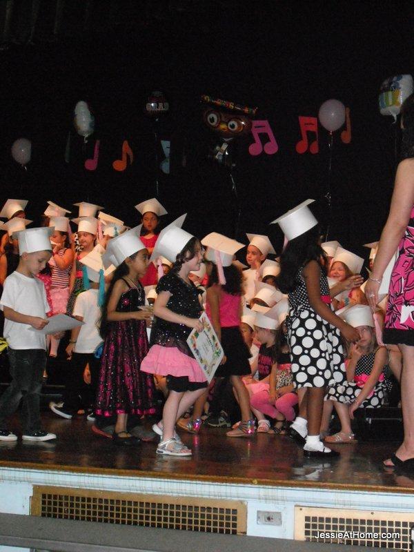 Vada-with-deploma-kindergarten-graduation-June-2013
