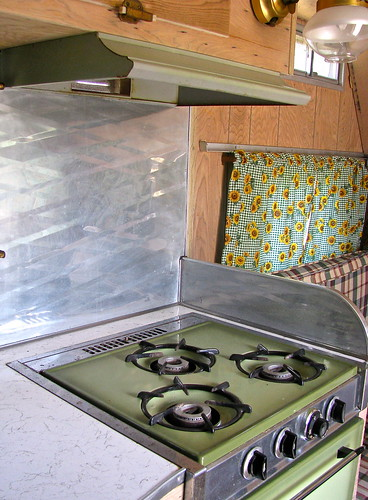 Look at that lovely metal backsplash!