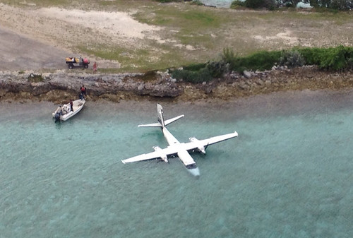 A downed twin engine aircraft is shown in the vicinity of Staniel Cay, Bahamas after the two people aboard attempted a precautionary landing Sunday Nov. 3, 2014. The two men were recovered and transported by a Coast Guard MH-60 Jayhawk helicopter crew from Air Station Clearwater, Fla., to Nassau with no injures. U.S. Coast Guard photo