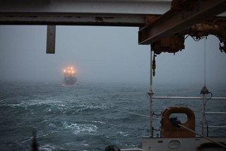 The Coast Guard Cutter Waesche tows the fishing vessel Alaska Mist through the Bering Sea near Amak Island, Alaska, Nov. 13, 2013. Joint effort between the crew of the Coast Guard Cutter Waesche, and a Coast Guard Air Station Kodiak MH-60 Jayhawk helicopter crew, the 207-foot tug Resolve Pioneer and the fishing vessel Pavlof resulted in the successful tow of the Alaska Mist and safe disembarkation of the crew to Dutch Harbor. U.S. Coast Guard photo by Coast Guard Cutter Waesche.