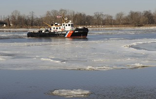 The Coast Guard Cutter Capstan, a 65-foot ice-breaking tugboat homeported in Philadelphia, breaks ice on the Delaware River, near the Burlington-Bristol Bridge, Thursday, Jan. 9, 2014. The Capstan crew worked to help prevent flooding and maintain navigable waterways. U.S. Coast Guard photo by Petty Officer 3rd Class Cynthia Oldham