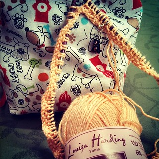 Cast on something cute for a special little lady who has a birthday coming up... #knitstagram #knitting #LouisaHarding sparkly #yarn Teutul #stitchmarker #dogs #knittingbag