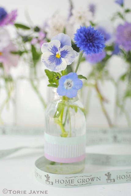Bottle of home grown flowers