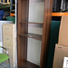 Tall walnut open bookcase