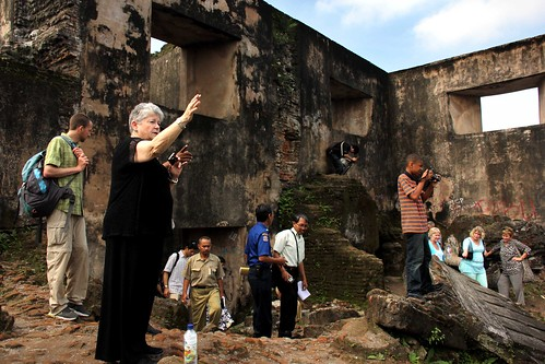 group visiting palace ruins in Indonesia