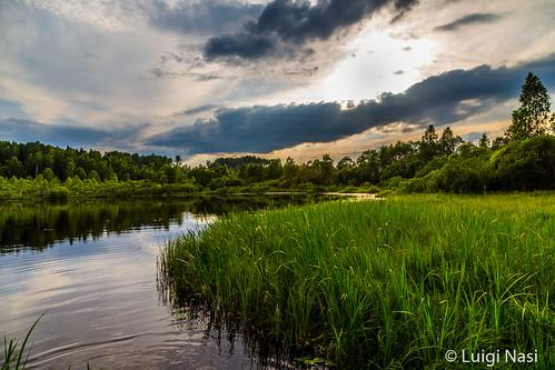 sunset lake water latvia contryside