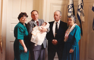 Lt. j.g. Matthew Chase, shown at his baptism at the Coast Guard Academy chapel with his mother Carroll, father Kim and grandparents in 1989. Chase progressed on to graduate from the Coast Guard Academy in 2011 and subsequently fulfilled his lifelong dream of becoming a Hercules pilot. Chase family photo