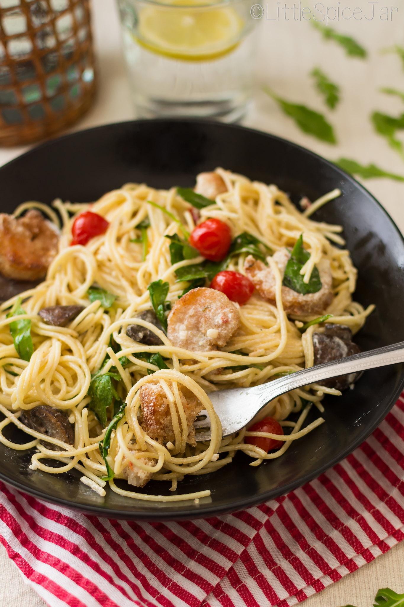 shrimp and pasta on fork