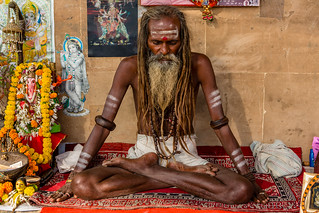 Stoned sadhu praying in the Holy ghat in Varanasi, India | by Phil Marion