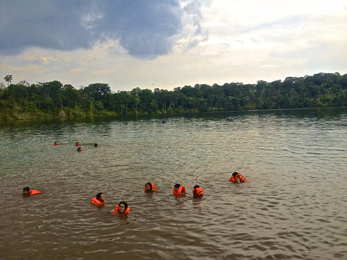 "Cambodians ""swimming"" in Yeak Laom volcanic crater lake. Pretty much everyone on the lake was wearing a life jacket."