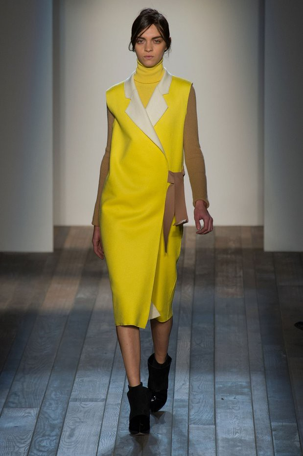 yellow sleeveless trench jacket, Victoria Beckham's Fall 2013, white blouse, pastel blue trousers,  nude heels, Victoria Beckham's aviator sunglasses & bag from her Spring 2013 collection, Victoria Beckham