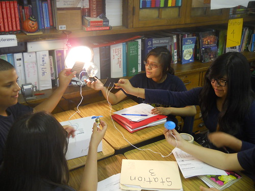 IB students studying power produced by light energy.  © Brad Parker