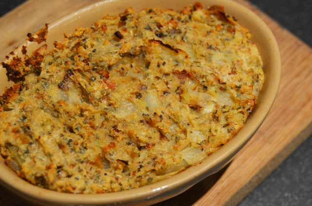 traditional sage and and onion stuffing in a retro pie dish