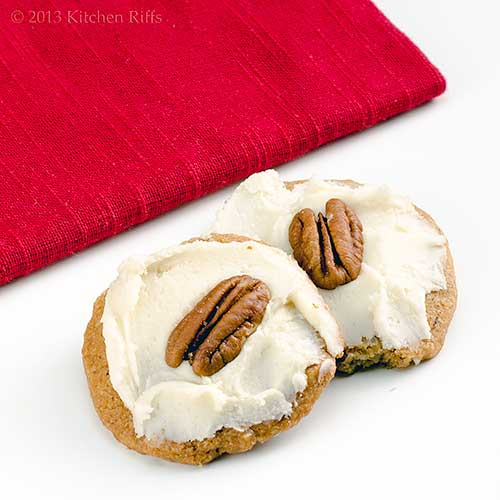 Rum-Frosted Pecan Shortbread Cookies with napkin in background