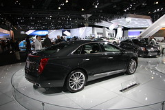 automobile(1.0), exhibition(1.0), executive car(1.0), wheel(1.0), vehicle(1.0), cadillac xts(1.0), automotive design(1.0), auto show(1.0), mid-size car(1.0), sedan(1.0), land vehicle(1.0), luxury vehicle(1.0),