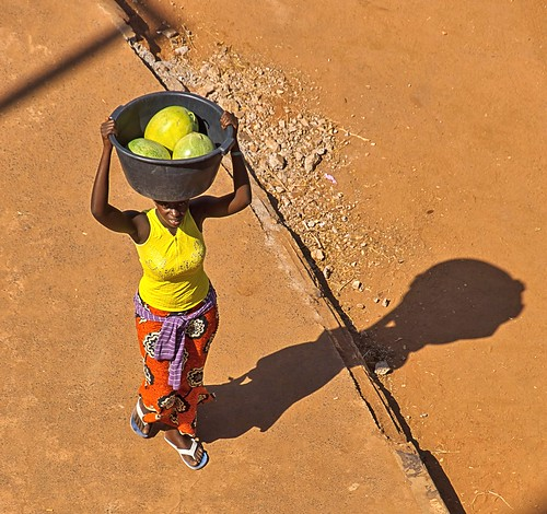 melon lady colorful colourful clothes fruit carying head tub basket arch22 banjul height overhead shadow sony sonya65 a65 slta65 africa thegambia holiday ladywithmelons onhead flickrbronzetrophygroup people person