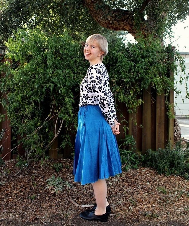 black-and-white floral blouse, bright blue midi skirt