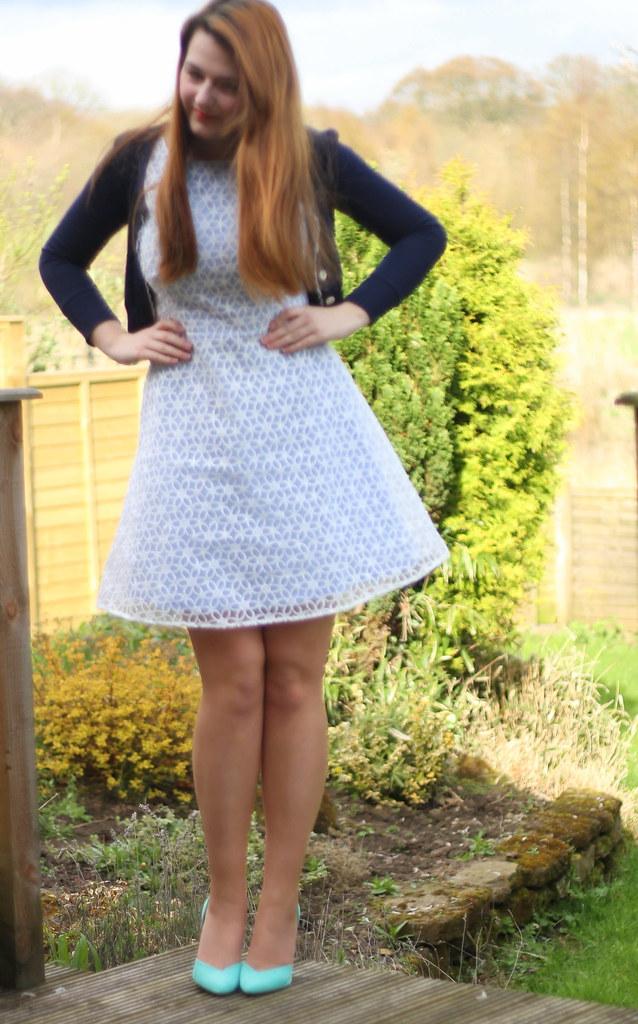Pastel dress with navy cardigan
