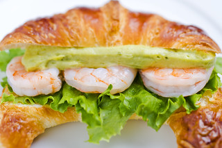 Croissant sandwitch with shrimp and avocado