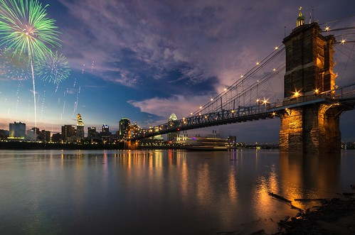 city sunset ohio skyline reflections midwest downtown fireworks cincinnati unitedstatesofamerica northamerica oh bluehour suspensionbridge ohioriver roebling queencity greatamericanballpark