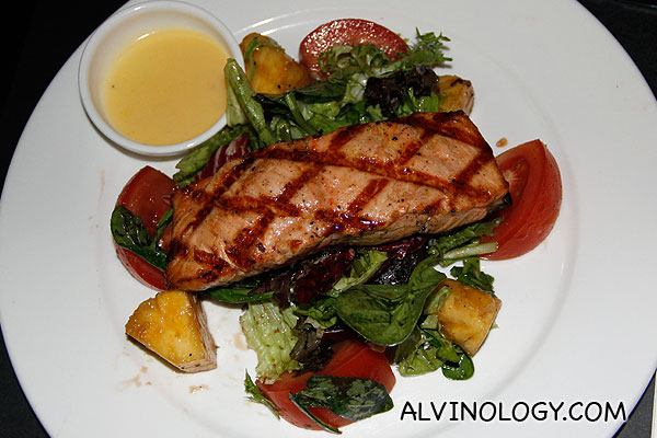 Pan roasted salmon steak (Garden salad, tomato, pineapple and lemon butter sauce) - S$29