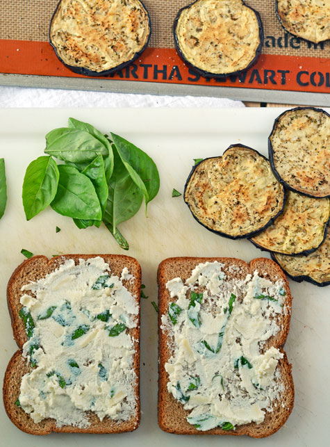 Eggplant rounds, basil leaves, and two slices of bread with cheese