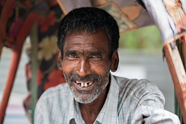 Portrait of a smiling Rikshaw driver in Guwahati, India.