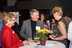Mary Miller, Director and Vera LeFranc chatting with Hero, Dr. Ken Stones