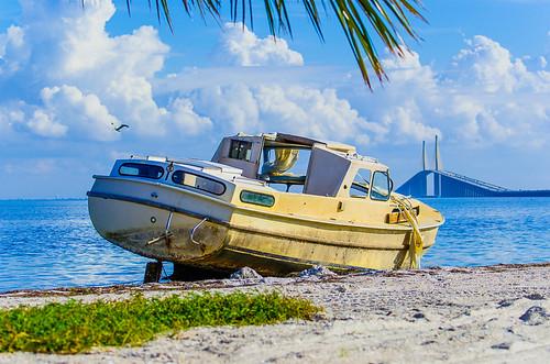 Derelict boat on the beach at Sunshine Skyway Bridge