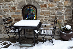 Table and Chairs Covered With Snow
