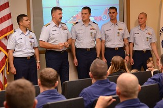 Rear Adm. Karl L. Schultz, 11th Coast Guard District commander, presented a Coast Guard Air Station San Francisco MH-65 Dolphin aircrew with an Air Medal and three Coast Guard Commendation Medals during a ceremony held at the air station Friday, Dec. 20, 2013. The aircrew was awarded for their rescue of six stranded hypothermic hikers near Point Reyes, Calif., July 30, 2013. (U.S. Coast Guard photo by Petty Officer 2nd Class Barry Bena)