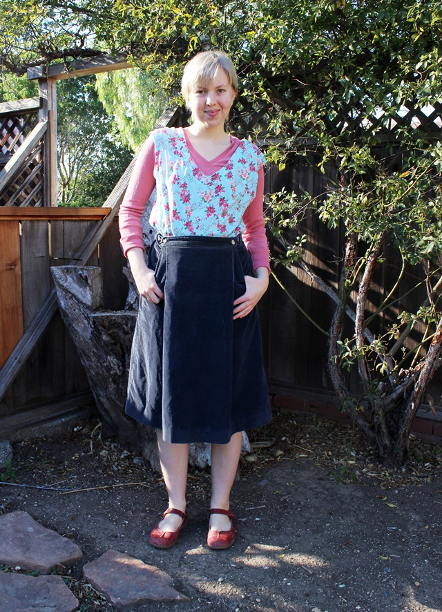 minty blue floral top over salmon v-neck sweater, navy blue corduroy skirt, burgundy mary janes