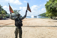 Petty Officer 3rd Class Andre' Brown, assigned to USS Somerset (LPD 25), directs a landing craft air cushion onto the beach in Sri Lanka, Nov. 23. (U.S. Navy/PO3 Amanda Chavez)