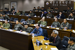 Leaders review briefs prior to beginning an anti-submarine warfare working group in Busan. (U.S. Navy/LT. Joshua Kelsey)