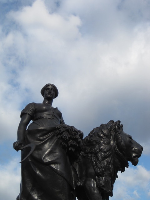 girl & lion statue in London