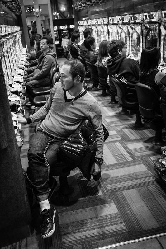 A man slumped in his seat as he gambled at a Pachinko parlour in Shinjuku.