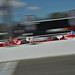 Scott Dixon and Justin Wilson streak across the start-finish line at Sonoma Raceway