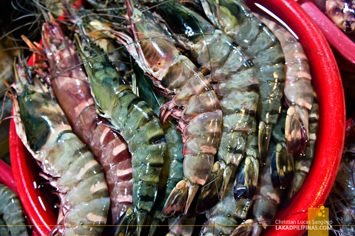 Buying Prawns at Seafood Dampa in Macapagal
