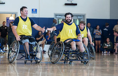 In this file photo, two players from the Navy wheelchair basketball team congratulate each other during the Wounded Warrior Pacific Invitational at Joint Base Pearl Harbor-Hickam's Fitness Center in January 2014. (U.S. Navy/MCSA  Rose Forest)