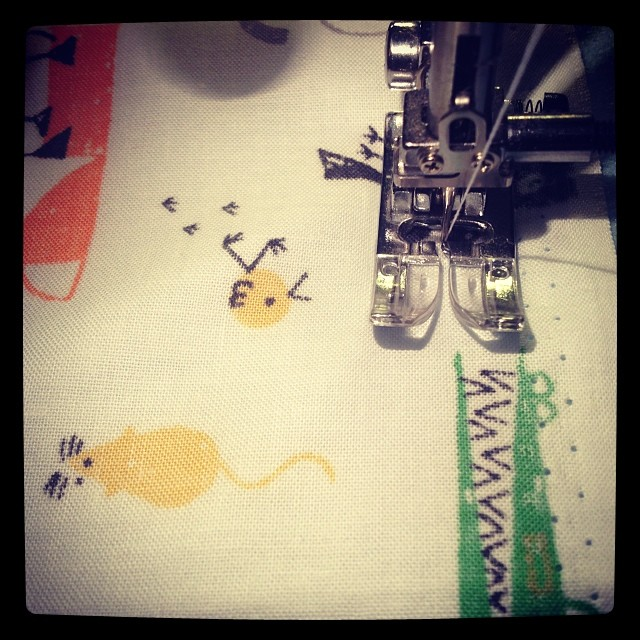 Sewing something special for my new baby niece with my precious Ed Emberley fabric #edemberley #sewing #fabric