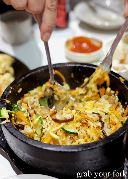 Mixing the egg yolk and gochujang into the dolsot bibimbap at The Sparrow's Mill, Sydney