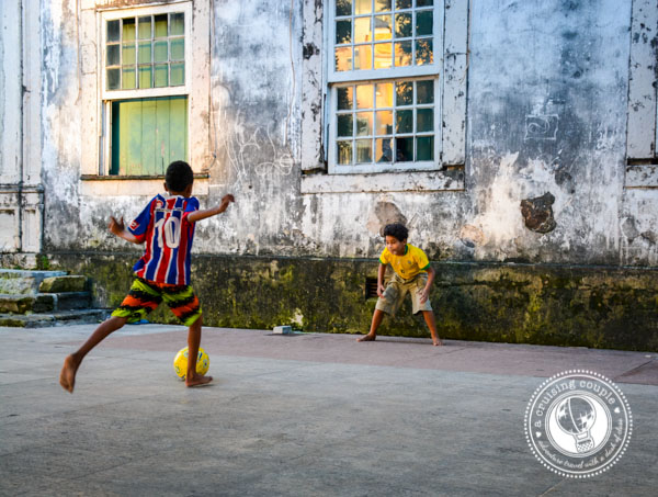 Kids Playing Football in the Street During World Cup