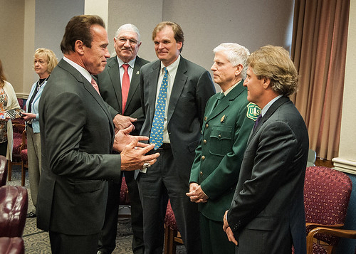 Former California Governor Arnold Schwarzenegger was named an Honorary Forest Ranger today during a ceremony at the USDA Whitten Building. Pictured are (right to left) Leo Kay, Director, Forest Service Office of Communication; Thomas Tidwell, Chief, U.S. Forest Service; Undersecretary Robert Bonnie; Deputy Undersecretary Arthur (Butch) Blazer, and former Governor Schwarzenegger (Photo by Bob Nichols, USDA)