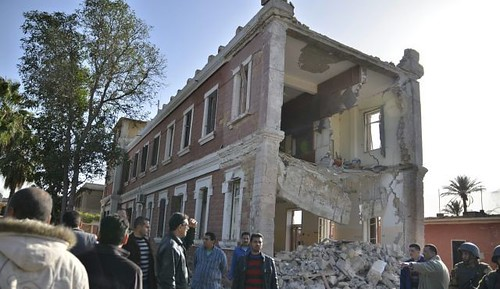 Egyptian army building bombed on December 29, 2013. Violence escalated after the announcement of the banning of the Muslim Brotherhood. by Pan-African News Wire File Photos